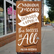 Famous Milton Hershey Quotes | individual success depends upon the success of all | Milton Hershey quote on a sign